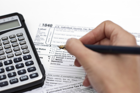 Tax documents and calculator on desk
